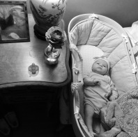 Bassinet, saddled between my vanity and bed. Her bed for first three months